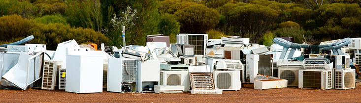Appliances Ready for Disposal Sitting Outdoors