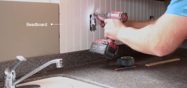 Man installing a Beadboard Backsplash