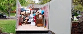 Roll Off Dumpster Halfway Loaded With Junk
