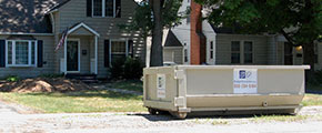 Roll Off Dumpster in Front of a House