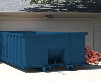 Dumpster With Pile of Bricks